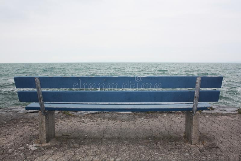 Blue bench on the lake in Switzerland. royalty free stock images