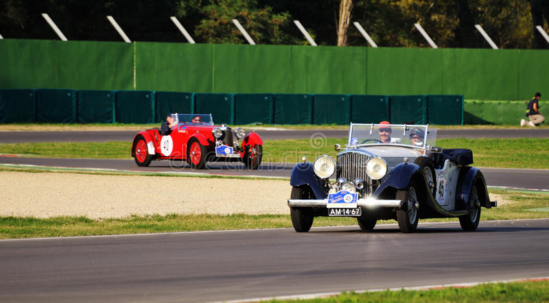 Blue Bentley Darby and red Aston Martin Le Mans stock images