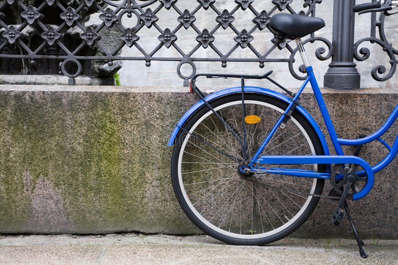 Blue Bicycle in Denmark. Blue bicycle stands against railings royalty free stock image