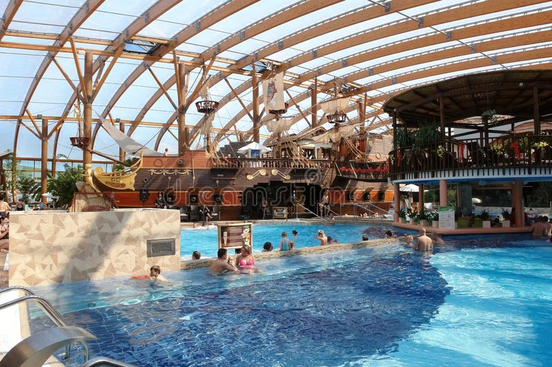 Blue big swimming pool and a pirate ship in the aquapark royalty free stock photos