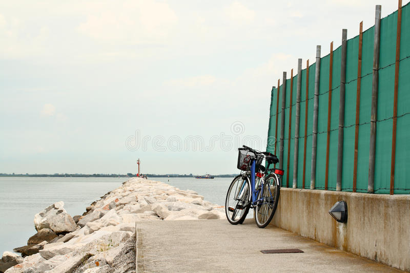 Download Blue Bike Parked By Rock Path Leading Into The Sea Stock Image - Image: 15574321