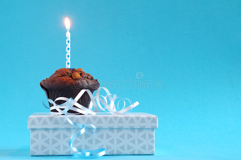 Blue birthday cake. With birthday candle royalty free stock photography