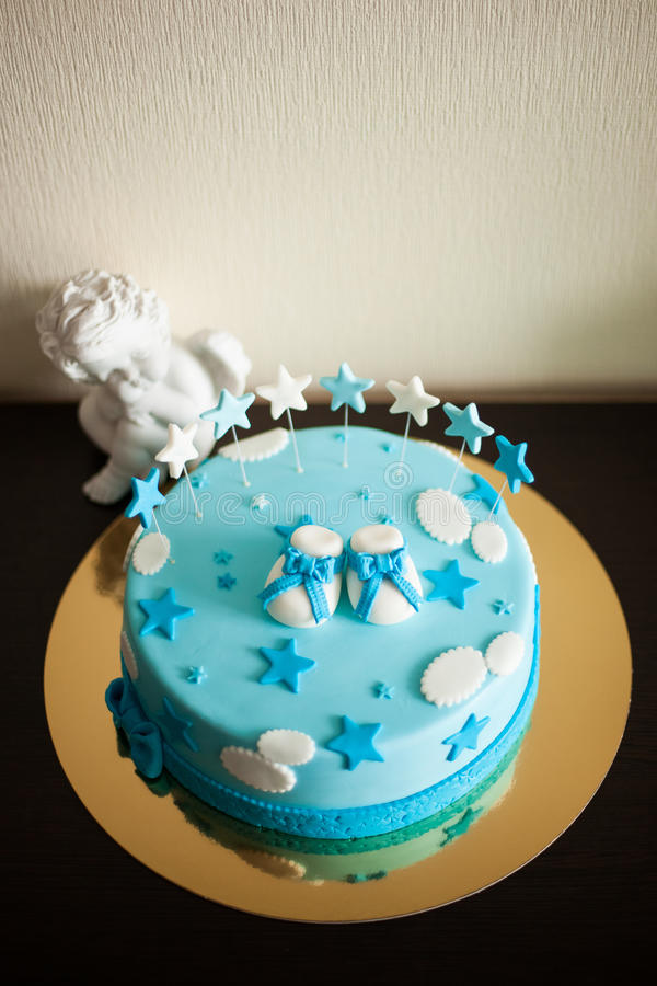 Blue birthday cake with stars royalty free stock photo