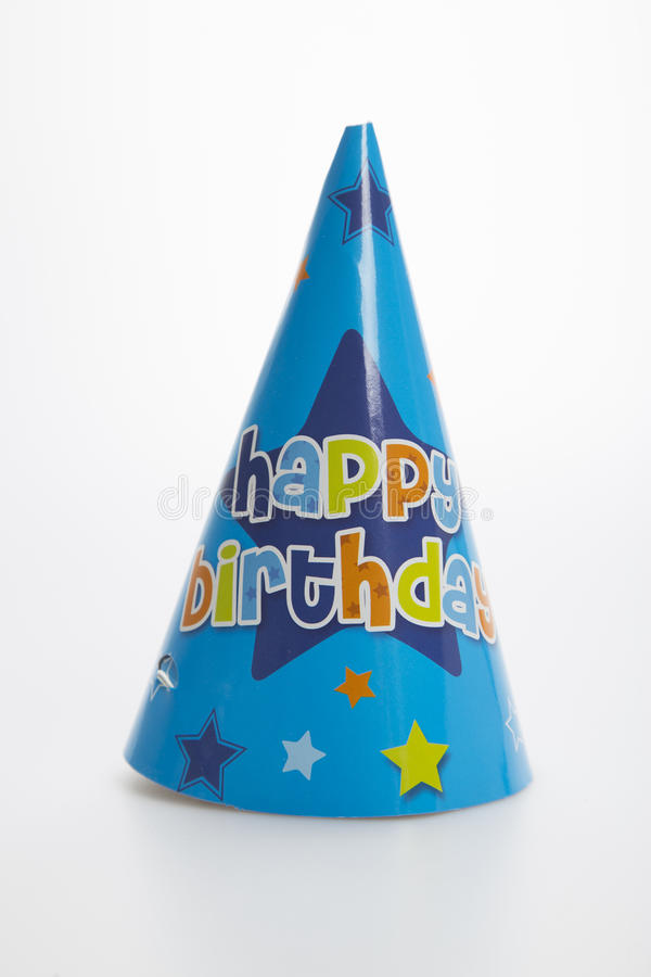 Blue birthday party hat. On a white background stock photos