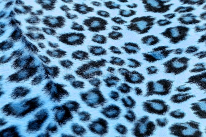 Blue Leopard Print. Blue and black leopard skin patterned fabric royalty free stock photography