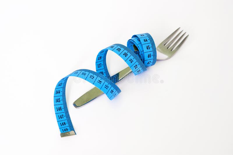 Blue and Black Measuring Tape Wrapped Around a Silver Metal Fork royalty free stock images