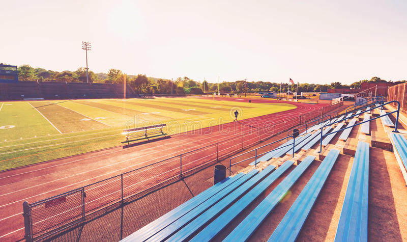 Blue bleachers in a sports stadium. Blue bleachers in a large outdoor sports stadium royalty free stock images