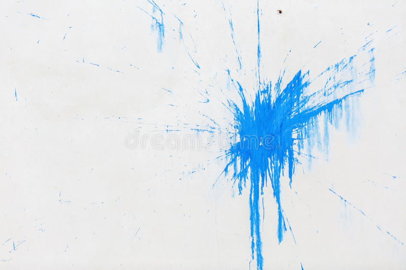 Blue blot on the wall. A large blue blot on the background of white plastered wall stock photography