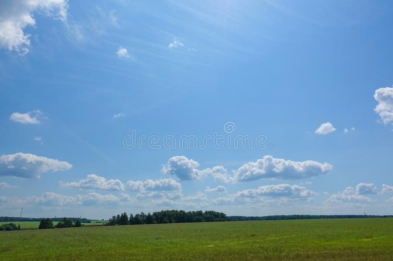 Blue blue sky with clouds. Beautiful countryside landscape stock photo