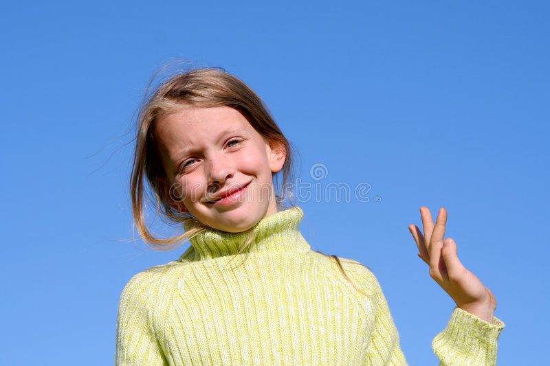 Blue, blue sky over me. Young girl saying Hello on the sky background royalty free stock images