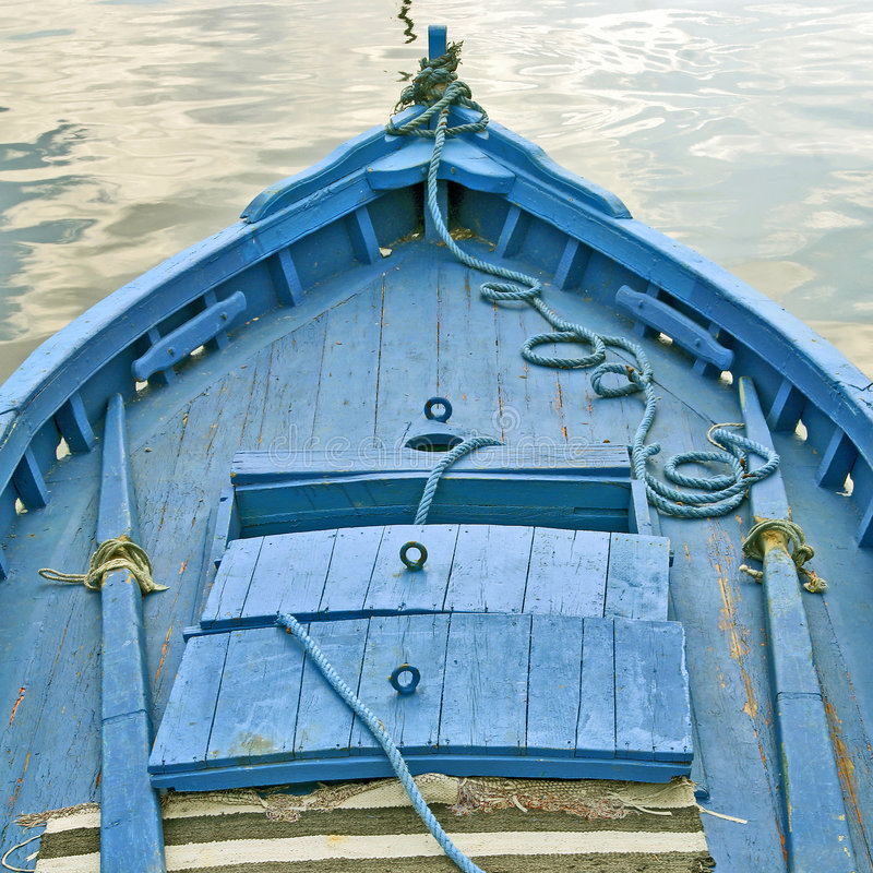 Blue boat. Bow of a blue boat stock image