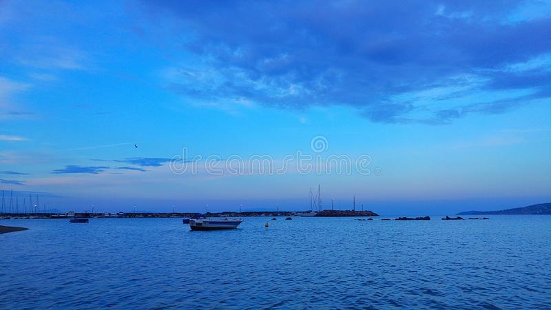 Blue and boat royalty free stock photos
