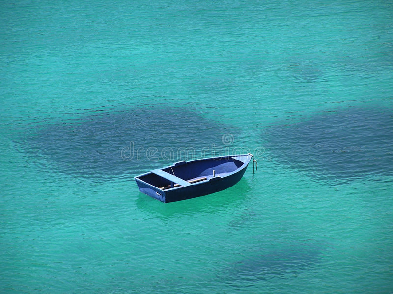 Blue boat in blue bay. Blue boat floating on exotic blue water, Alonisos island, Greece stock images