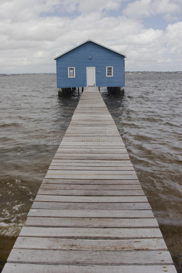Blue boat house on river. Scene of a refurbished 1930s Blue boat house on river stock image
