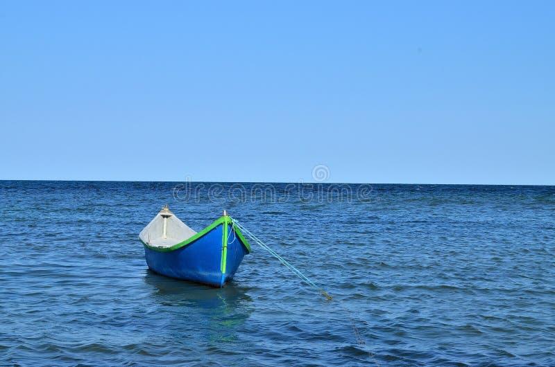 Blue boat at the Sea. Blue boat at Romanian Black Sea royalty free stock photos
