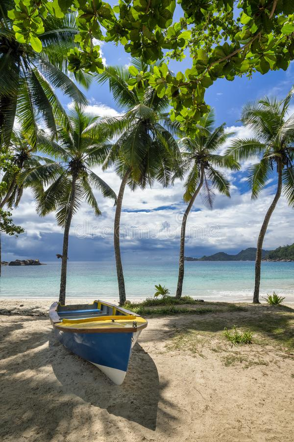 Blue boat on tropical ocean beach royalty free stock photo