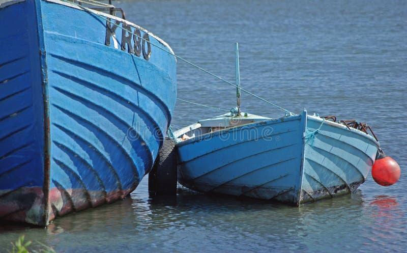 Blue boats stock photos