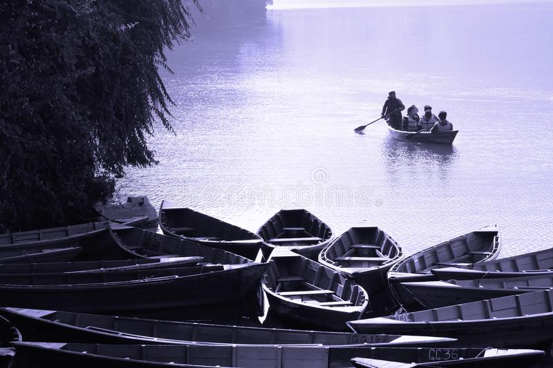 Blue boats in Nepal stock photo