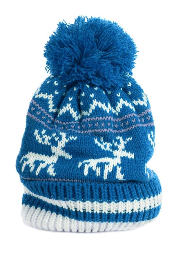 Blue bobble ski hat isolated white vertical reindeer pattern wool warm. Blue bobble ski hat isolated white vertical stock image