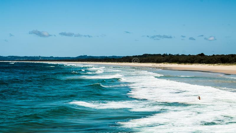 Blue Body of Water and White Sand Island royalty free stock image