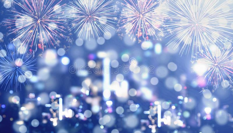 Blue Bokeh Background, blurred defocus Bokeh light of night city with celebration firework royalty free stock image