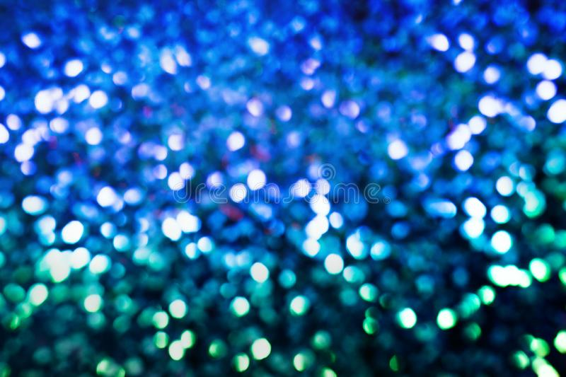 Blue bokeh background. Bokeh glittering shine bulbs lights background:blur of christmas wallpaper decorations concept.holiday festival backdrop:sparkle circle stock photos