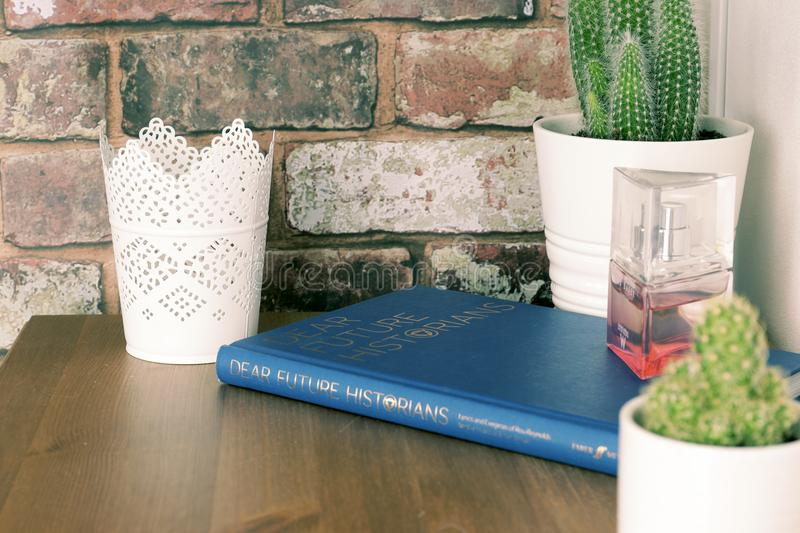 Blue Book on Brown Wooden Table with flower vases stock images