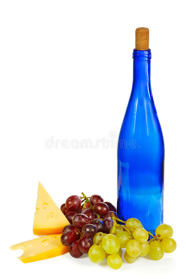 Blue bottle, grapes and cheese royalty free stock photos