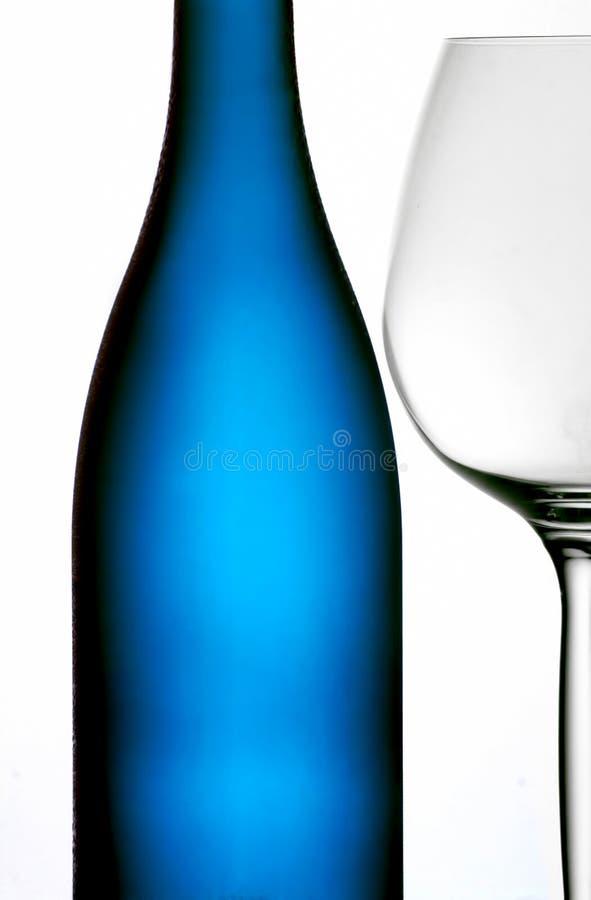 Download Blue bottle & wine glass stock photo. Image of stemware - 17413620