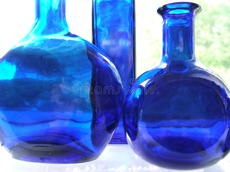 Blue bottles royalty free stock photography