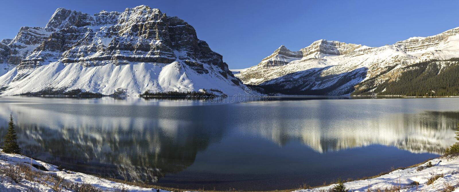 Bow Lake Panoramic Landscape Snowy Mountain Peaks Icefields Parkway Banff National Park. Blue Bow Lake and Snowcapped Rocky Mountains Panoramic Landscape on stock photography