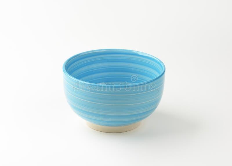 Blue bowl. Empty blue bowl on white background royalty free stock image