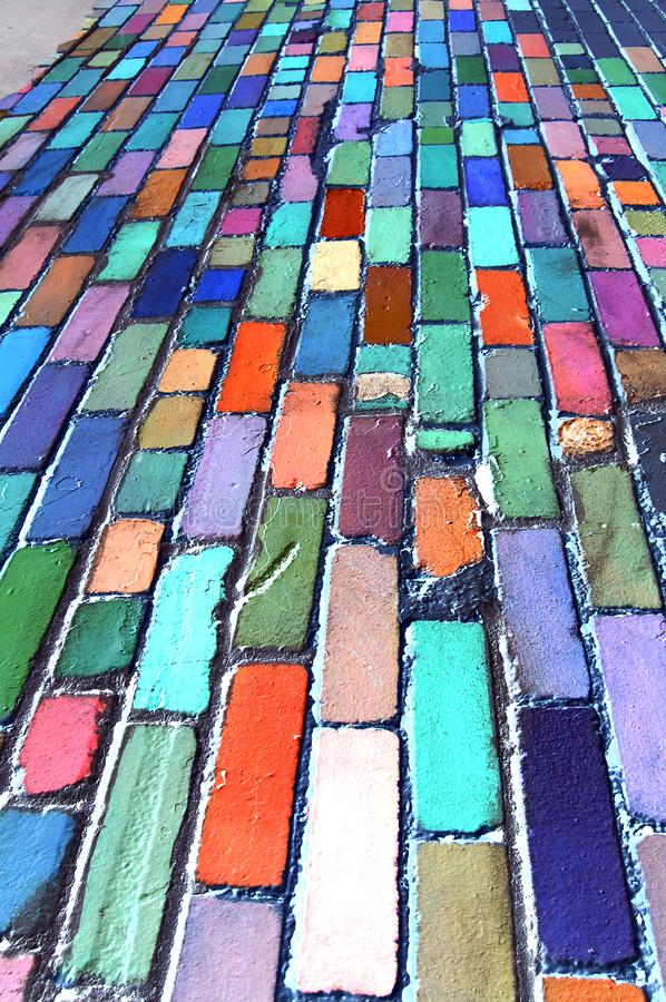 Blue Brick Abstraction. Old bricks painted in many colors form an abstract vertical linear design stock photography