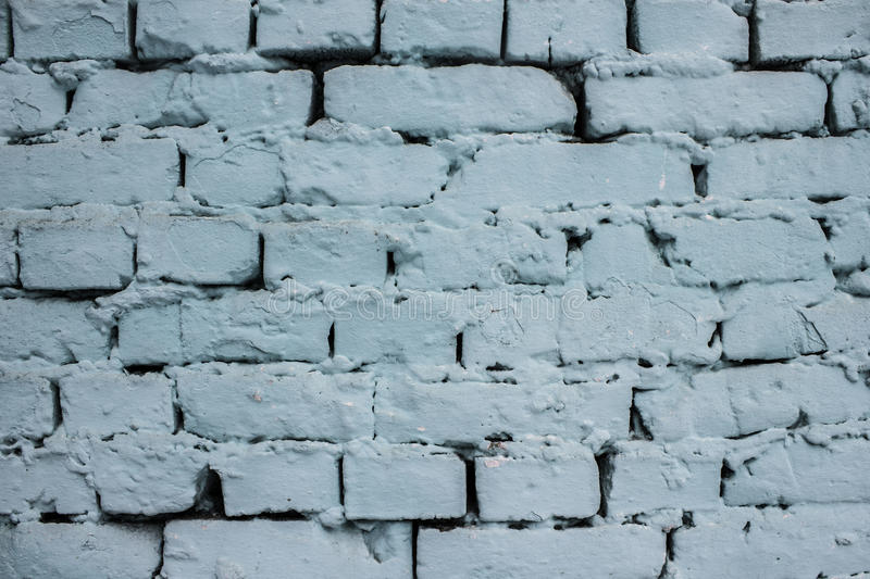 Blue Brick Wall with peeling paint background texture stock photos