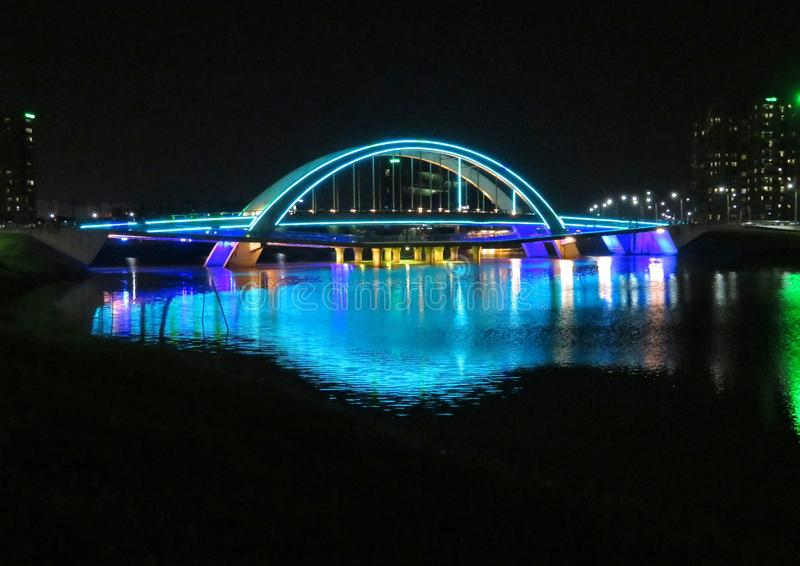 Blue bridge at night royalty free stock photography