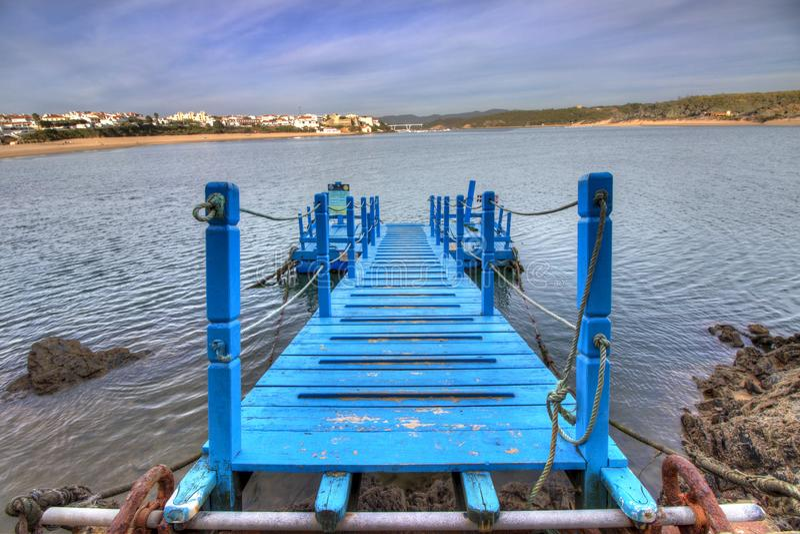 Blue bridge over the water. stock photo