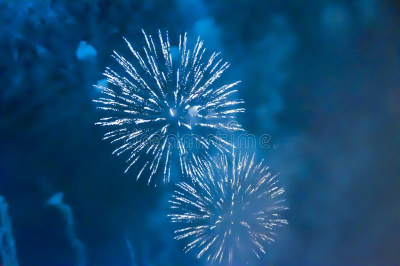 Yellow orange bright blurred fireworks effect abstract colorful background holiday. Blue bright blurred fireworks effect abstract colorful background holiday royalty free stock photos