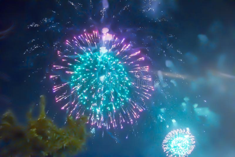 Blue bright blurred fireworks effect abstract colorful background holiday. Celebration stock images