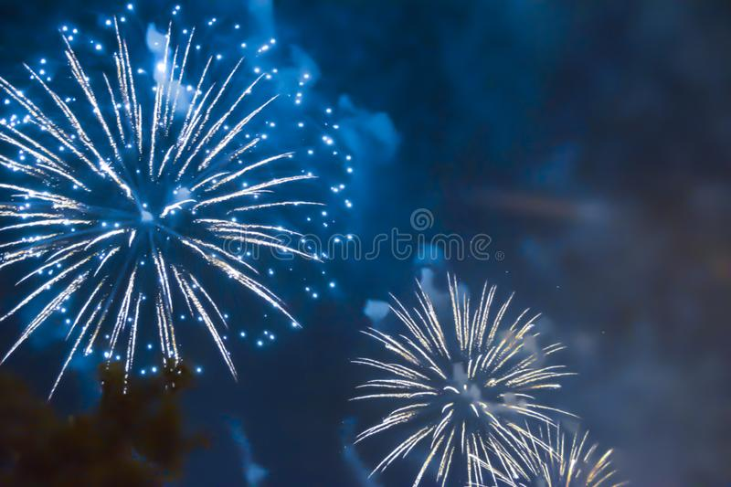 Blue bright blurred fireworks effect abstract colorful background holiday. Celebration royalty free stock image