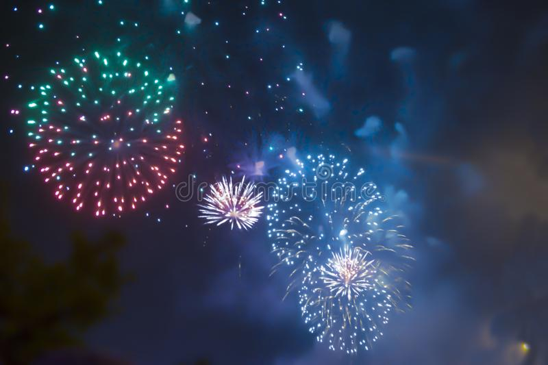 Blue bright blurred fireworks effect abstract colorful background holiday. Celebration stock photo