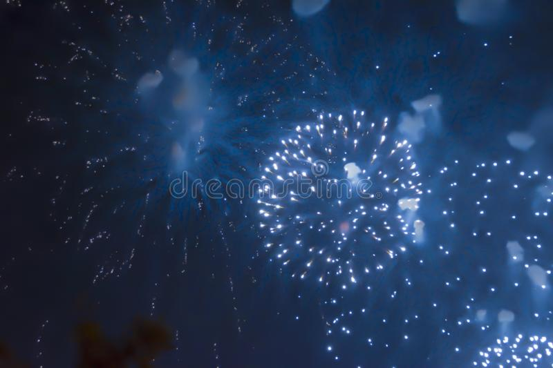 Blue bright blurred fireworks effect abstract colorful background holiday. Celebration stock photography