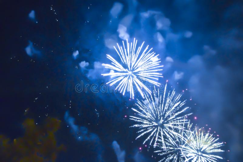 Blue bright blurred fireworks effect abstract colorful background holiday. Celebration stock image