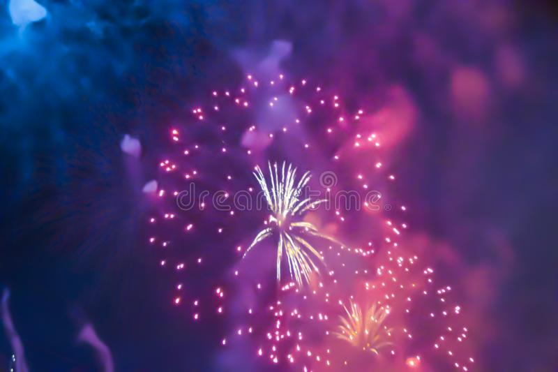 Red violet bright blurred fireworks effect abstract colorful background holiday. Blue bright blurred fireworks effect abstract colorful background holiday stock photography