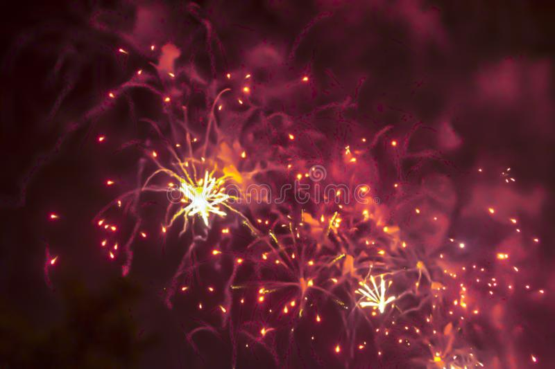 Red violet bright blurred fireworks effect abstract colorful background holiday. Blue bright blurred fireworks effect abstract colorful background holiday royalty free stock photo