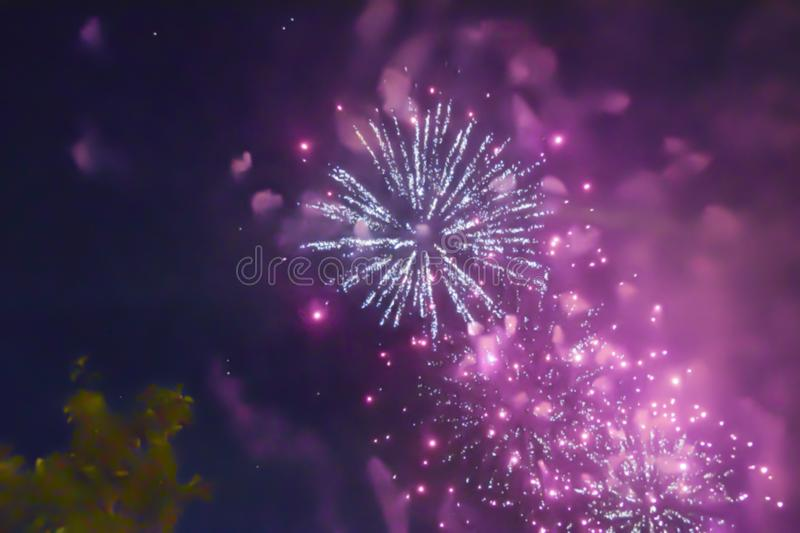Red violet bright blurred fireworks effect abstract colorful background holiday. Blue bright blurred fireworks effect abstract colorful background holiday royalty free stock photography