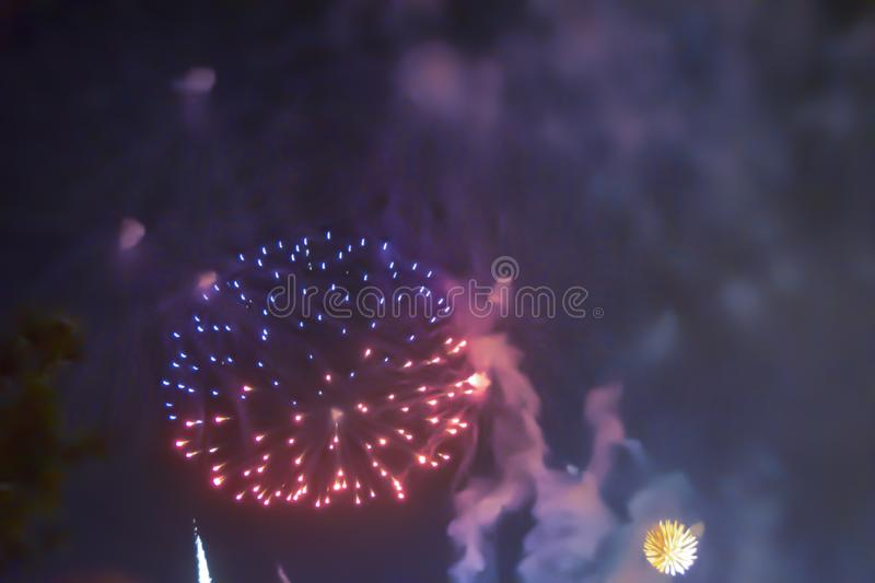 Red violet bright blurred fireworks effect abstract colorful background holiday. Blue bright blurred fireworks effect abstract colorful background holiday royalty free stock photos