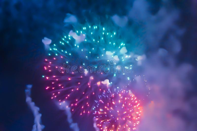 Violet blue bright blurred fireworks effect abstract colorful background holiday. Blue bright blurred fireworks effect abstract colorful background holiday royalty free stock images
