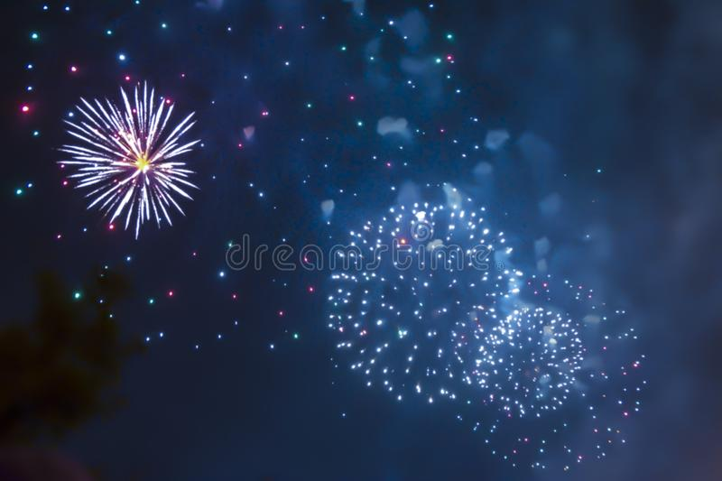 Violet blue bright blurred fireworks effect abstract colorful background holiday. Blue bright blurred fireworks effect abstract colorful background holiday stock photo