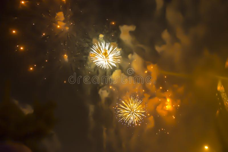 Yellow orange bright blurred fireworks effect abstract colorful background holiday. Blue bright blurred fireworks effect abstract colorful background holiday stock image