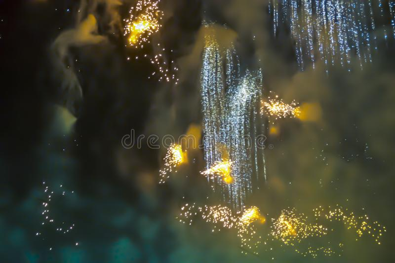 Yellow orange bright blurred fireworks effect abstract colorful background holiday. Blue bright blurred fireworks effect abstract colorful background holiday stock photo